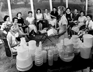 Women gather at a Tupperware home party in 1958. First introduced in 1948, Tupperware home demonstrations were so effective at communicating the benefits of the revolutionary Tupperware seal, that by 1951, all Tupperware products were taken off of store shelves to be distributed in this manner. Almost fifty years later, the demonstration remains key to the success of Tupperware products. (AP Photo/Tupperware)